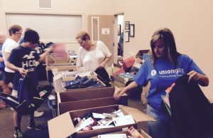 Volunteers at the Chatham-Kent United Way filling 1,200 back packs for students returning to school. August 31, 2015 (Photo by Simon Crouch)