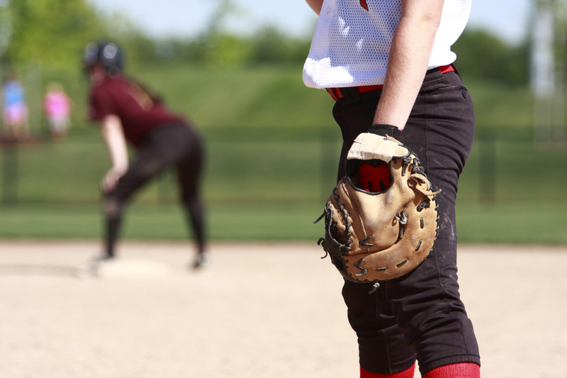 Softball players on the field. © Can Stock Photo Inc. / pklick360