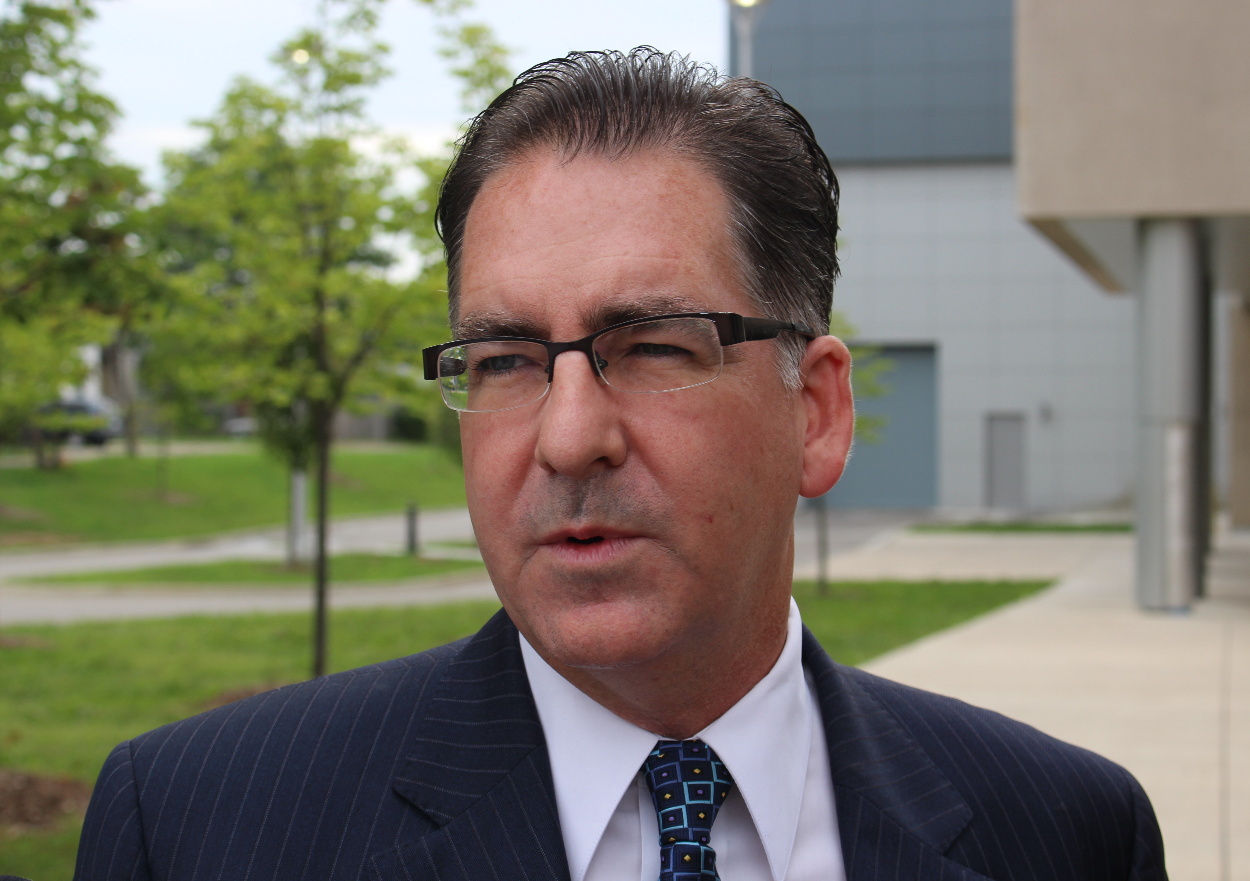 Windsor-West NDP MP Brian Masse speaks to the media out front of the University of Windsors Centre For Engineering and Innovation, September 9, 2015. (Photo by Mike Vlasveld)