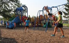 Kids play outside of the Forest Glade Community Centre in Windsor, September 1, 2015. (Photo by Mike Vlasveld)