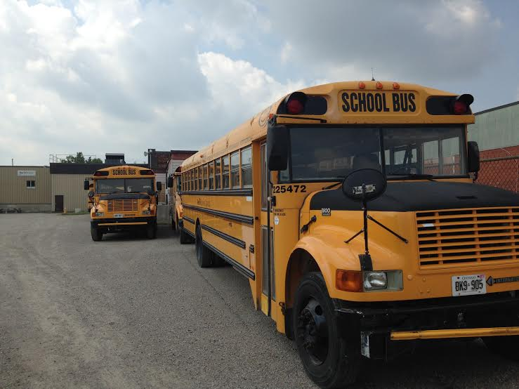School Buses in First Student Canada lot in Chatham, Sept. 2, 2015. (Photo by Simon Crouch)