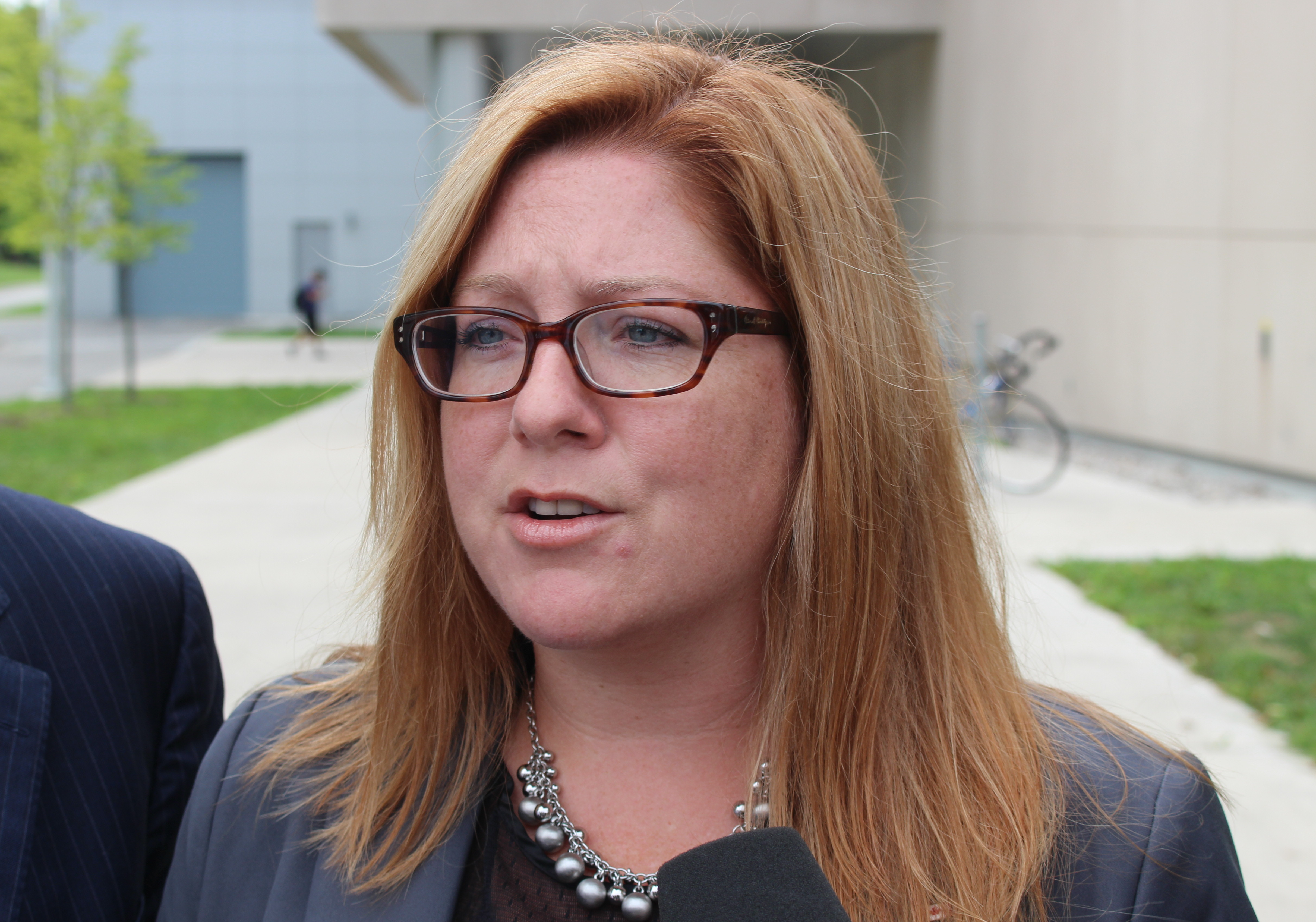 Essex NDP candidate Tracey Ramsey speaks to the media out front of the University of Windsors Centre For Engineering and Innovation, September 9, 2015. (Photo by Mike Vlasveld)