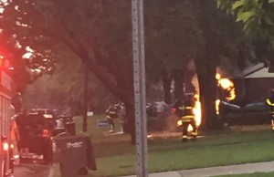 Fire crews work to put out lightning strike of tree and gas line on Belleperche Pl. in Windsor. (Photo courtesy Stephan Viselli)
