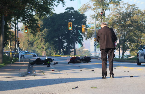 An investigator at the scene of a two-motorcycle crash on Riverside Dr. W, September 23, 2015. (Photo by Adelle Loiselle)