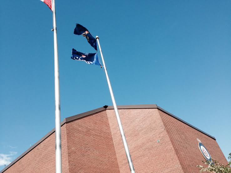 The Flag of the Canadian Association of Retired Persons flies above the Civic Centre in Chatham-Kent Oct. 1, 2015(Photo by Simon Crouch)