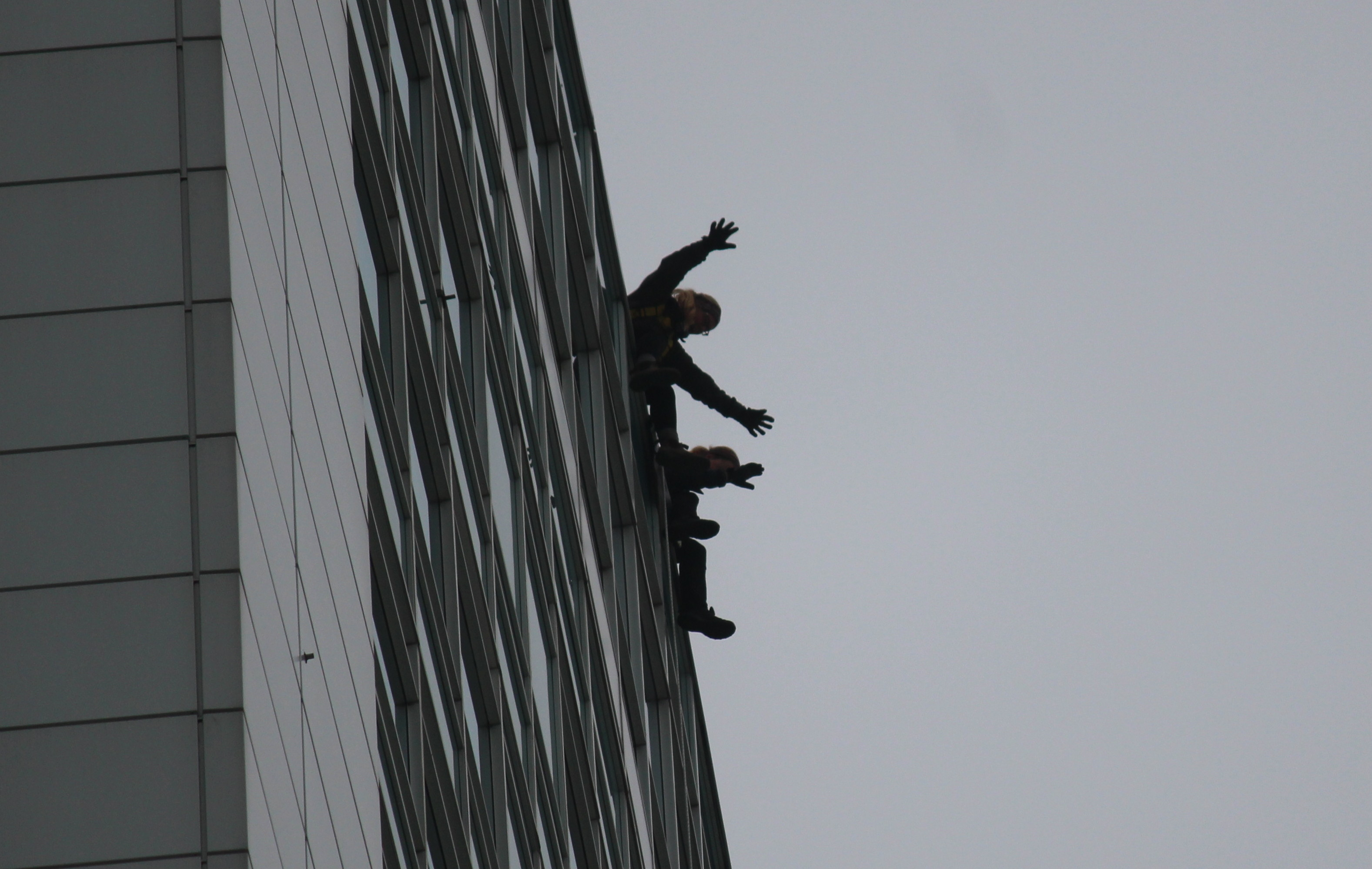 People rappel down the side of Caesars Windsor to raise money for local Easter Seals families through the charity's Drop Zone event, October 6, 2015. (Photo by Mike Vlasveld)