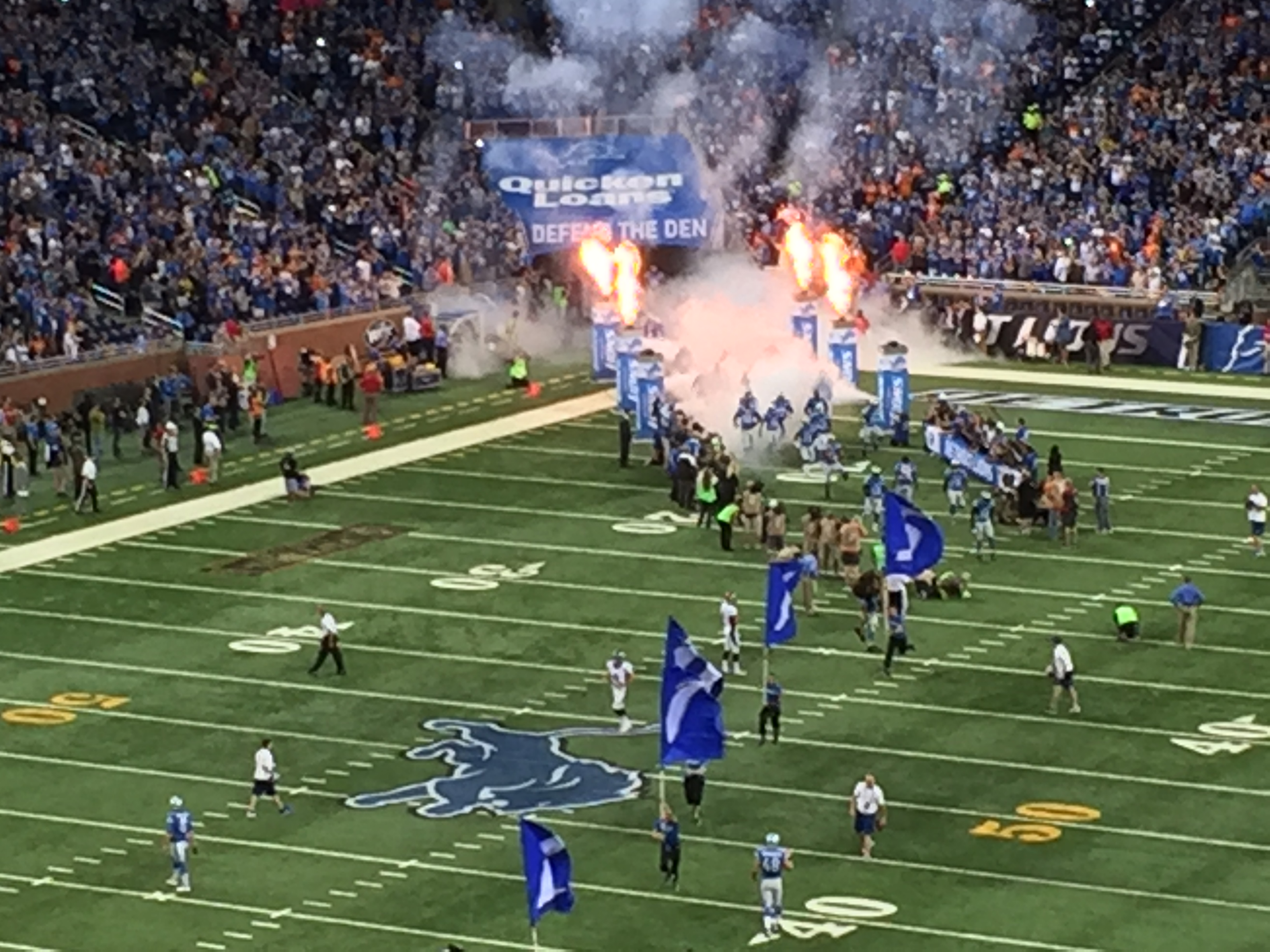 Members of the Detroit Lions run out of the tunnel at Ford Field. (Photo by Mike James)