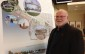 Leamington Mayor John Paterson stands by a conceptual drawings of a proposed development for the town's waterfront on October 9, 2015. (Photo by Kevin Black)
