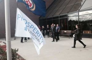Prosperity Round Table members preparing to market Poverty Awareness Week by raising a flag at the Civic Centre Oct. 13, 2015. (Photo by Simon Crouch)