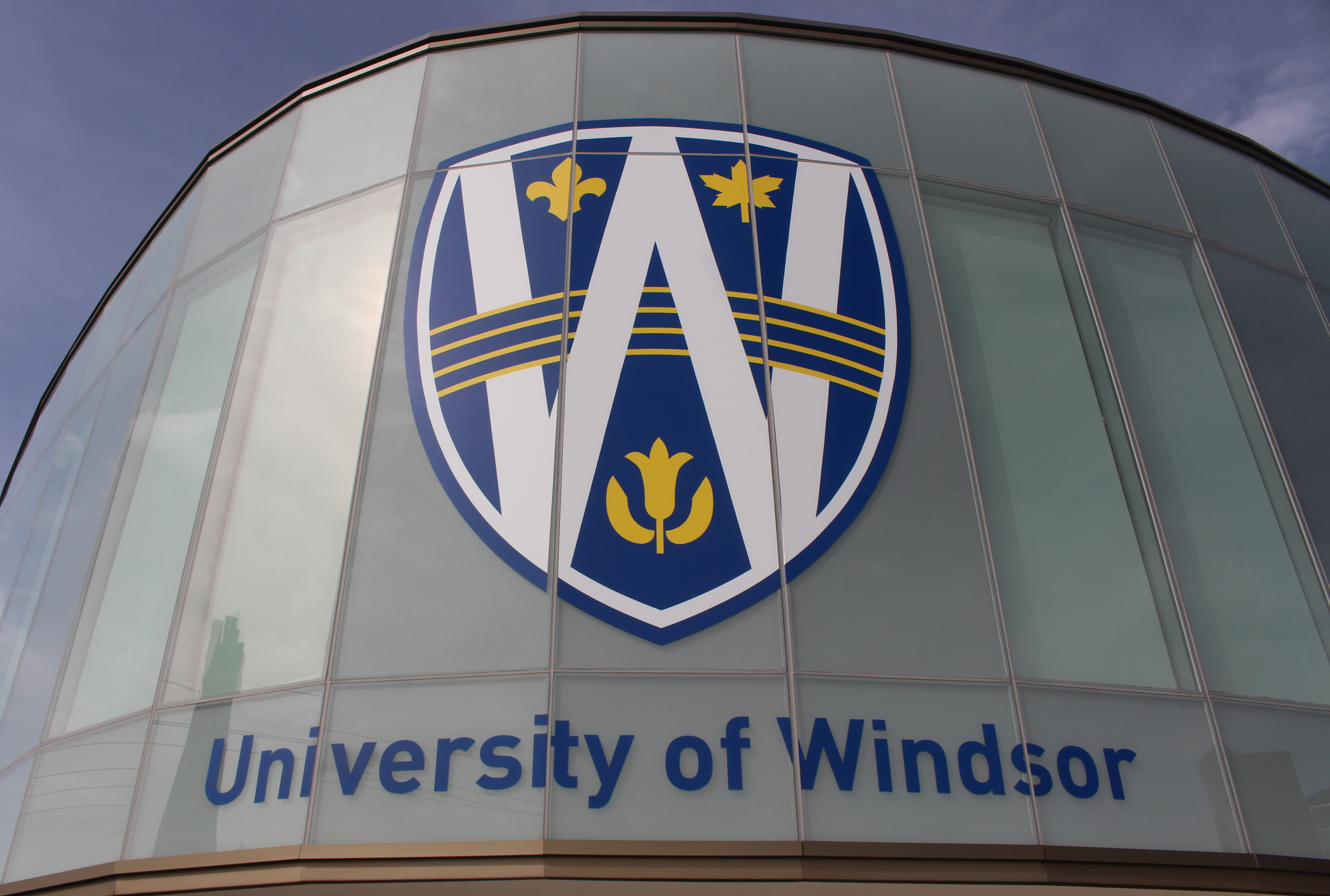 University of Windsor logo on the side of the new Stephen and Vicki Adams Welcome Centre, October 2, 2015. (Photo by Mike Vlasveld)