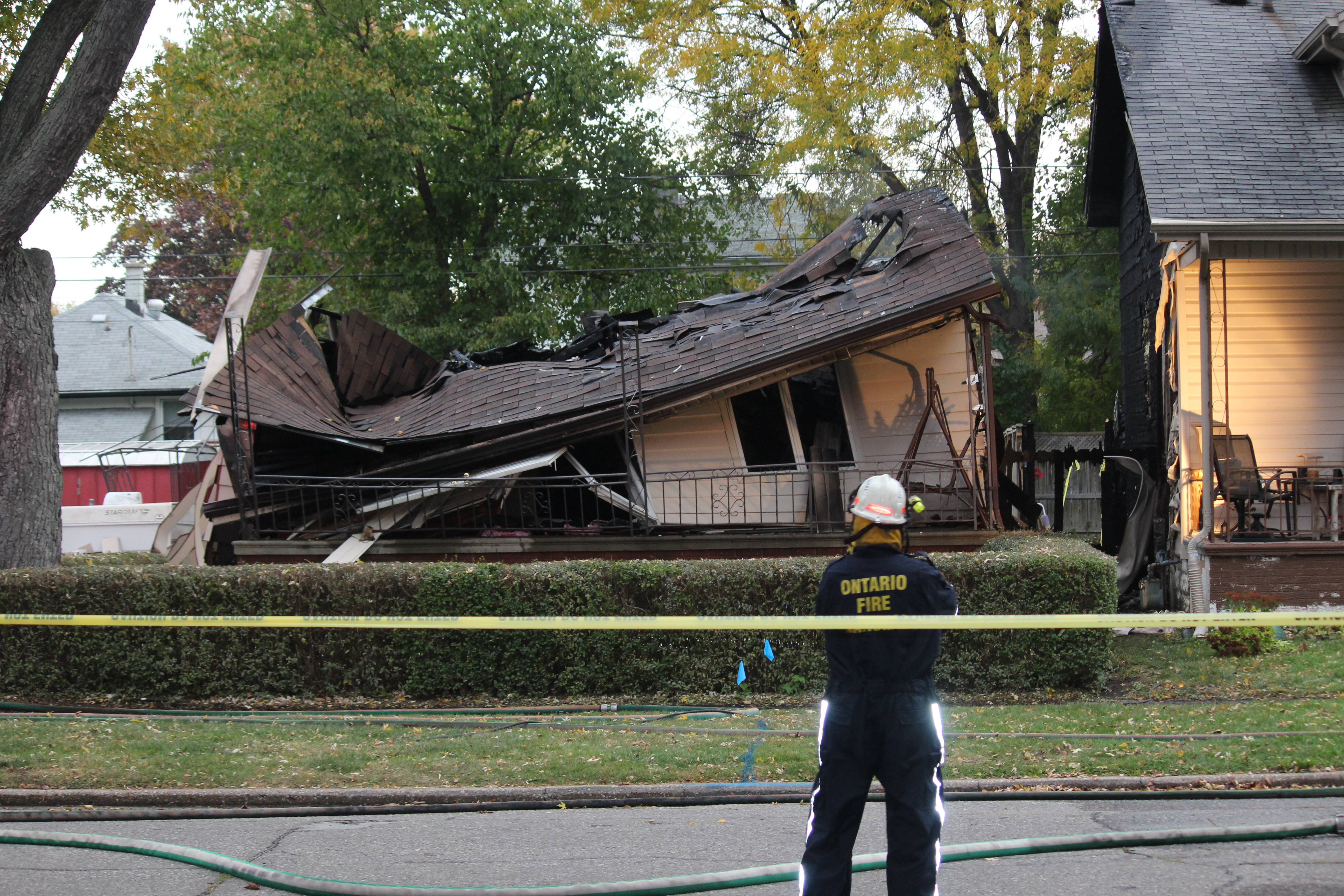 Officials from the Office of the Ontario Fire Marshal are investigating a house explosion in the 1400-block of Francois Rd. in Windsor, October 21, 2015. (Photo by Adelle Loiselle)