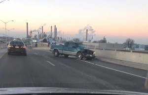 Pick up truck slides in winter conditions and collides with cement side barrier of the Donahue Bridge. November 30, 2015 (Photo submitted by Jessica Sutherland via Facebook).