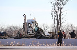 Emergency crews discuss removal of damaged transport following Hwy 401 crash at Tilbury Nov. 25, 2015. (Photo by Simon Crouch)