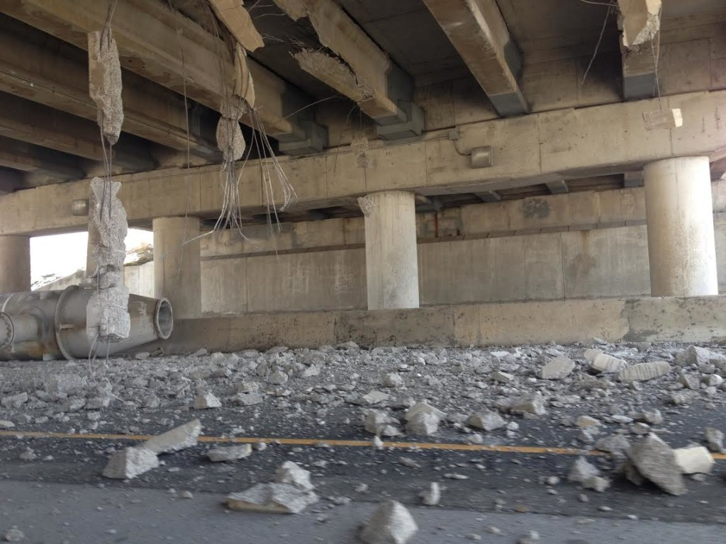 Transport truck collides with overpass