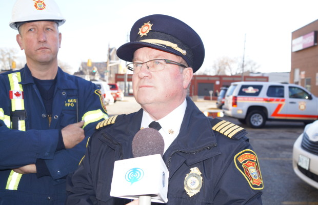 Sarnia Fire Chief John Kingyens updates media outside the Kenwick Place Apartment Building. November 25, 2015. Photo by Jake Jeffrey (blackburnnews.com)