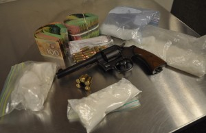Drugs, gun, ammunition, and cash seized during a raid in east London, November 23, 2015. (Photo courtesy of London police.)