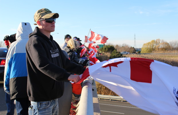 Supporters come out to the Communications Rd. overpass on Hwy. 401 for the repatriation ceremony of fallen veteran and Wheatley native John Gallagher on November 20, 2015. (Photo by Ricardo Veneza)