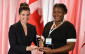 Pamela Ovadje receiving the Mitacs Award for Outstanding Innovation–Postdoctoral from Honourable Kirsty Duncan, Minister of Science, Government of Canada in Ottawa November 24, 2015. (Photo provided by Mitacs)