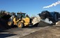 A front end loader mixes a new type of pot hole filling asphalt being made and sold at Pebbles Gravel and Topsoil. (Photo by Mike James)