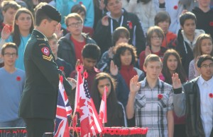 The oath of allegiance to Canada is taken at Windsor's Remembrance Day ceremony, November 11, 2015. (Photo by Mike Vlasveld)
