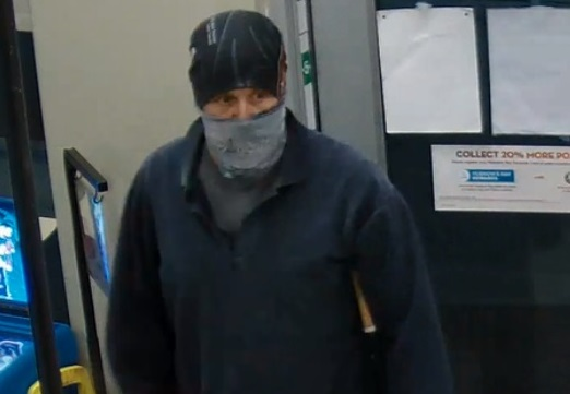 Police are looking for this suspect after a robbery at a Mac's Milk in Woodstock, November 12, 2015. (Photo courtesy of the Woodstock Police Service)
