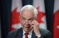 Minister of Immigration, Refugees and Citizenship John McCallum announces Canada's plan to resettle 25,000 Syrian refugees, at a news conference in Ottawa, Tuesday, Nov.24, 2015. THE CANADIAN PRESS/Sean Kilpatrick