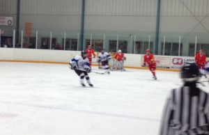 "The Saugeen-Maitland Lightning Midget ""AA"" team attack Team China's zone in an exhibition game in Wingham. (Photo by Steve Sabourin)"