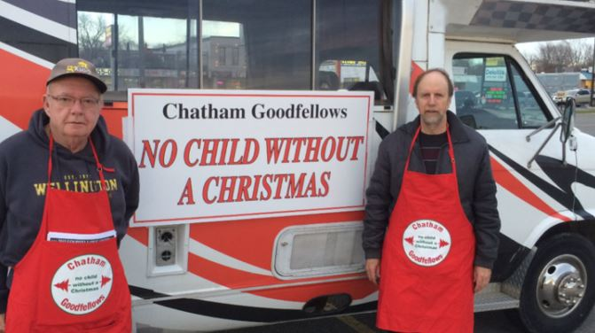Lee Harris and Peter Kralo of Chatham Goodfellows coordinate street sales volunteers at Nortown Plaza. (Photo provided by Chatham Goodfellows)