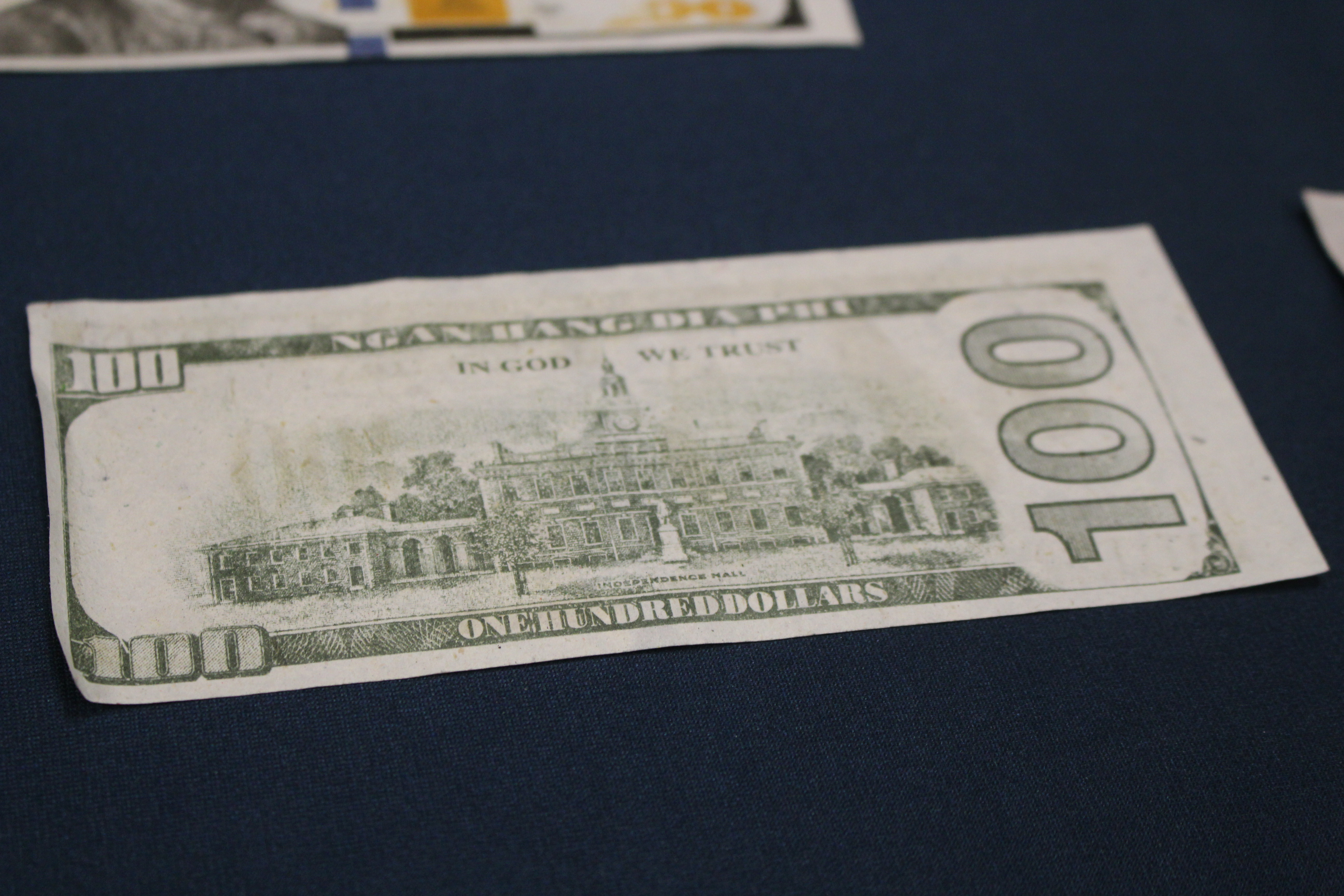 Counterfeit money found by the Windsor Police Service on display at media conference, December 1, 2015 (Photo by Maureen Revait)