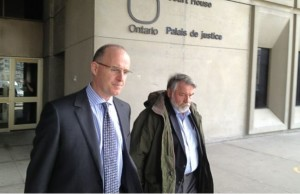 Stanley Dobrowolski leaves the London court house with his lawyer. Photo by Avery Moore, BlackburnNews.com