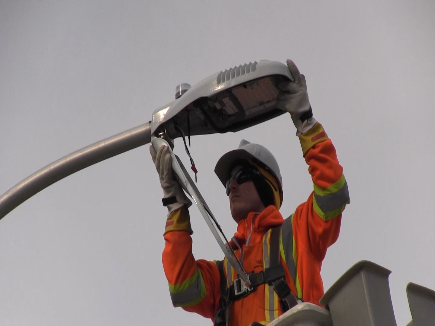 Chris Carr with Enersource Power Services installs an LED street light outside of St. Rose Catholic Elementary School in Windsor on December 9, 2015. (Photo courtesy City of Windsor)