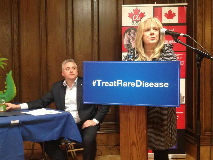 MPP Michael Harris and President of Alpha-1 Canada Mimi McPhedran discuss the challenges people with rare disease face getting treatment in Ontario, January 27, 2016. (Photo by Maureen Revait)