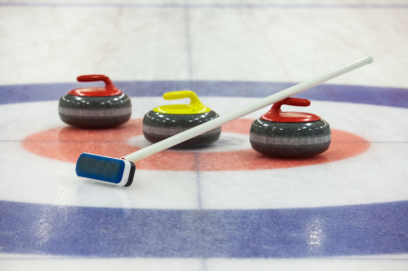 Curling rocks. © Can Stock Photo Inc. / gornostaj