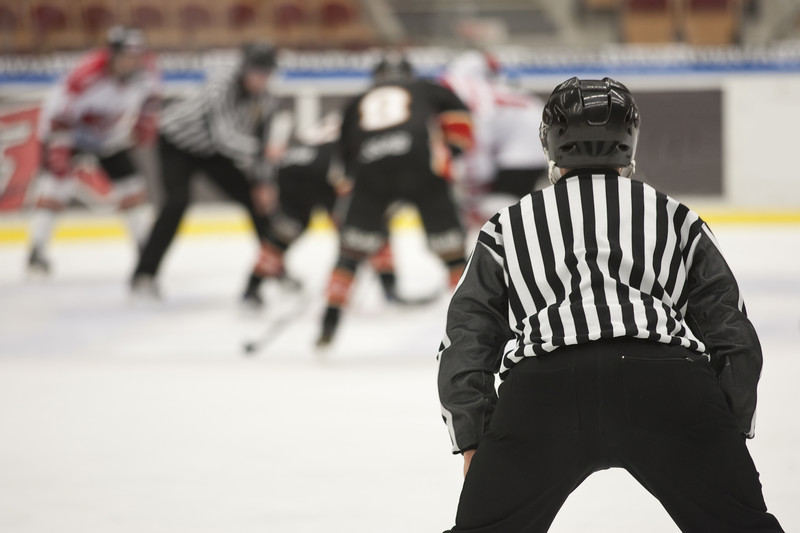Ice hockey game. Photo courtesy of © Can Stock Photo Inc. / Modestil