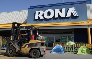 A man drives a forklift in front of a Rona home improvement store in St. Eustache, Que., just outside Montreal, on Thursday, July 16, 2015. The Lowe's home improvement chain is buying Quebec-based Rona Inc. in a deal valued at $3.2 billion. THE CANADIAN PRESS/Ryan Remiorz