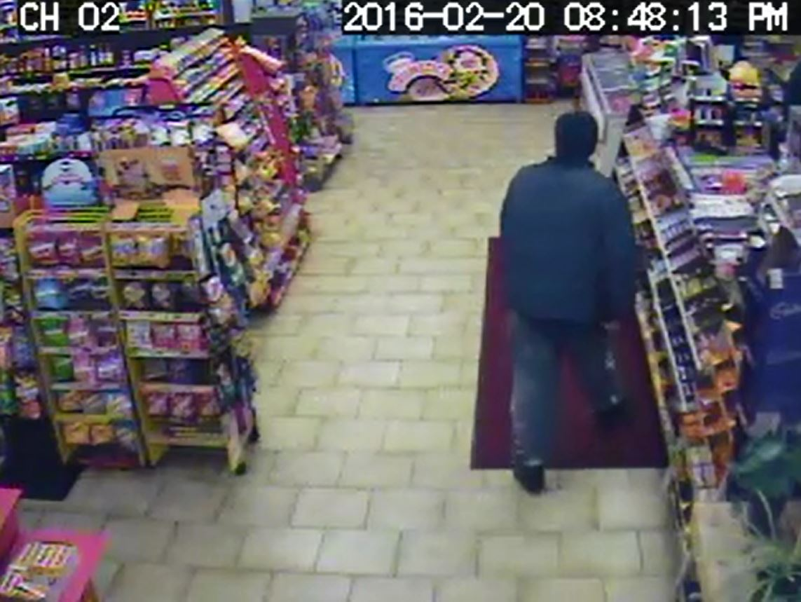Surveillance photo of robbery suspect at Happy Days Variety Store provided by London police.