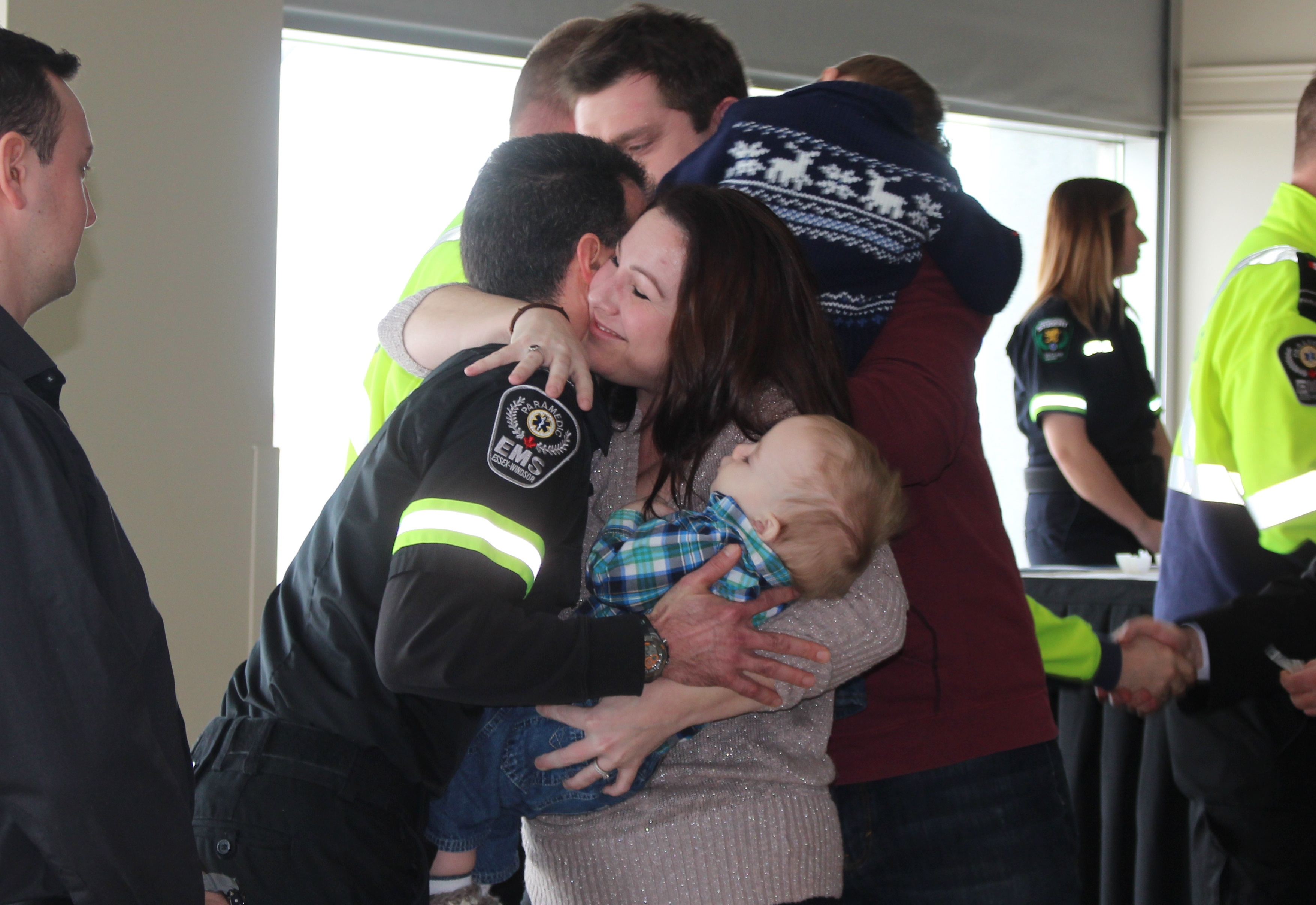 Mom Catherine Marcoux thanks paramedic Rick St-Pierre for helping to save her life and the life of her son Roman on EMS Survivor Day, February 26, 2016.