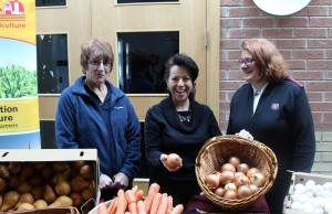 Kent Federation of Agriculture representative Mary Anne Udvari marks Food Freedom Day with Brenda LeClair (left) and Salvation Army Captain Stephanie Watkinson. February 9, 2016 (Photo by Simon Crouch)