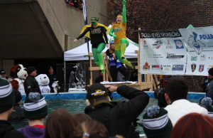 Two costumed St. Clair College students jump into a pool during the 2nd Annual Polar Plunge for Special Olympics Ontario at the College's main campus in Windsor, February 4, 2016 (Photo by Mark Brown)