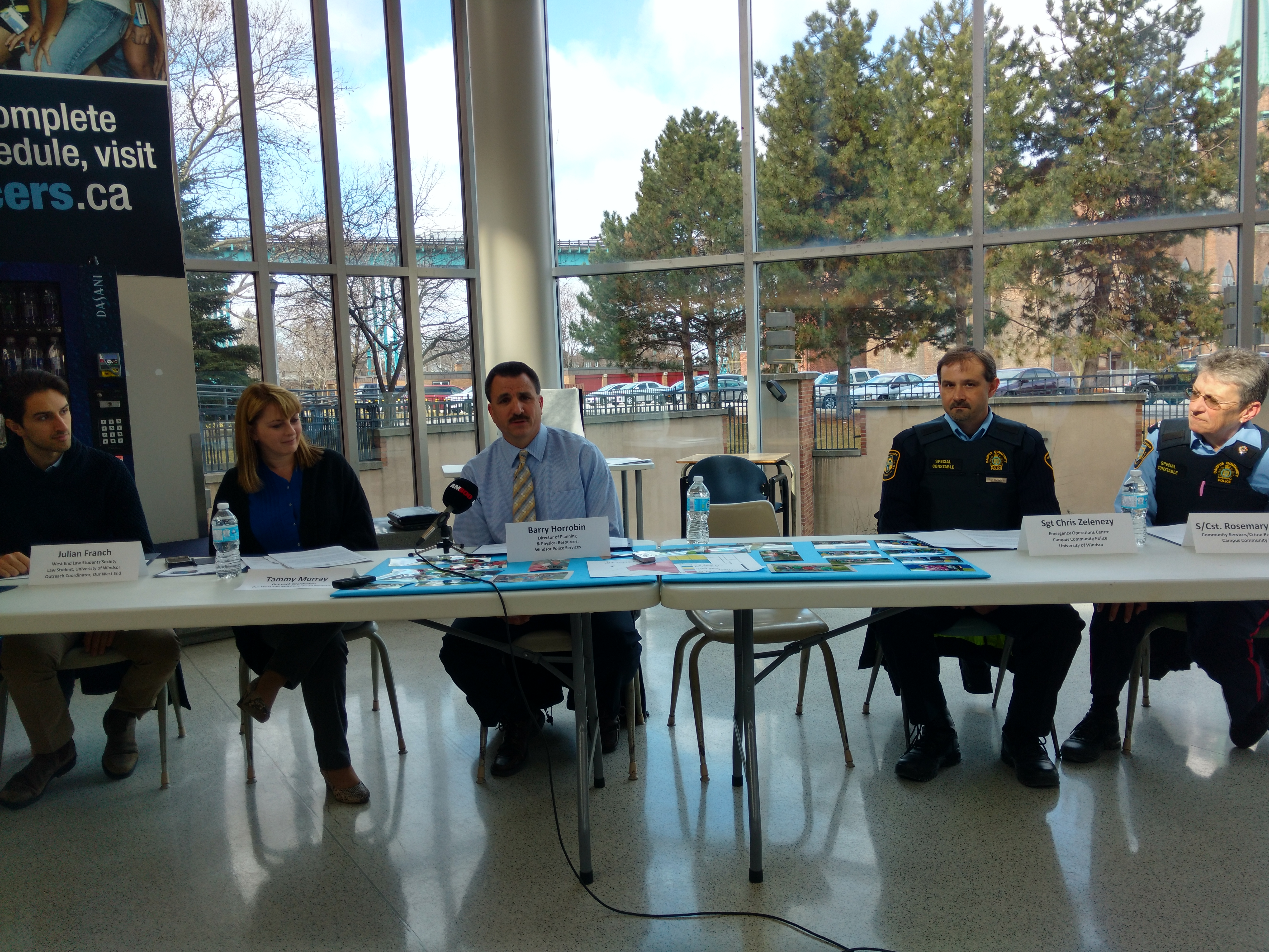 From left, Julian Franch of the University of Windsor, Tammy Murray of Our West End, Barry Horrobin, Windsor Police director of planning, Sergeant Chris Zelezney and Constable Rosemary Briscoe participate in a press conference highlighting a partnership between police and Our West End at the UW CAW Student Centre in Windsor, Feb 29 (Photo by Mark Brown)