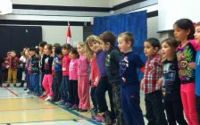 """Students at West Gate Public School sing a song called """"Differences,"""" at a Black History Month assembly, February 2, 2016. (Photo by Mike Vlasveld)"""