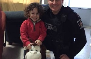 Two-year-old Elijah Moulden (left) and Chatham-Kent Police Const. John Hicks. (Photo courtesy Chatham-Kent Police Service)