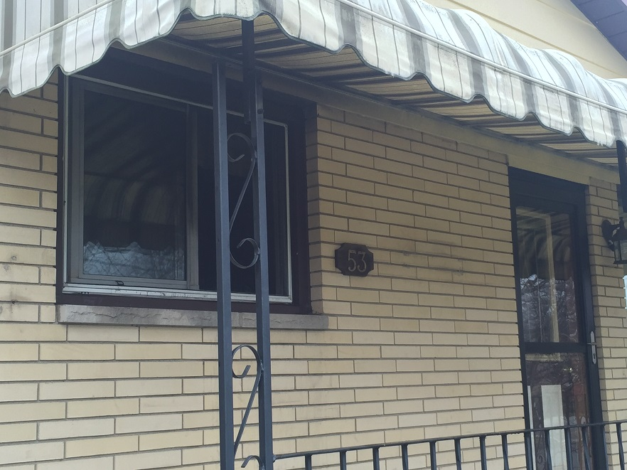 Only some dark spots around a front window reveal a fire took place inside this Houston St. home. (Photo by Mike James)