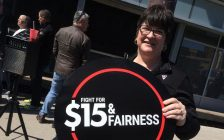 A demonstrator attends a downtown Windsor rally supporting $15/hr minimum wage in Canada. Photo taken April 15, 2016. (Photo by Ricardo Veneza)