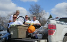 Jay Stanford, London's director of environment, fleet and solid waste and volunteers with a truck load of garbage collected during the 22 Minute London Makeover, April 22, 2016. Photo by Miranda Chant, Blackburn News.