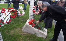 Red flowers were laid at Sarnia's Firefighters' Memorial Garden on East St. Thursday for the National Day of Mourning. April 28, 2016 (BlackburnNews.com Photo by Briana Carnegie)