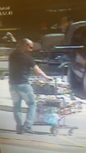 An unknown man leaving the Chatham Walmart without paying, April 14, 2016 (Photo courtesy of Chatham-Kent police)