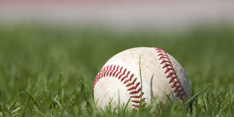 Baseball sitting in grass. © Can Stock Photo Inc. / Stevemc