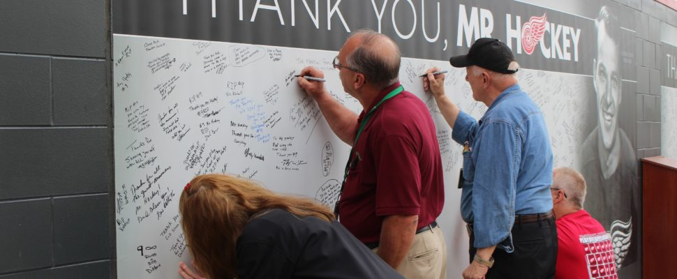 Fans write messages to Gordie Howe as the family holds visitation inside Joe Louis Arena, June 14, 2016. (Photo by Maureen Revait)