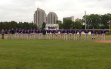London Majors players line up along the third base line at Purple in the Park 2015. Photo courtesy of the London Abused Women's Centre.